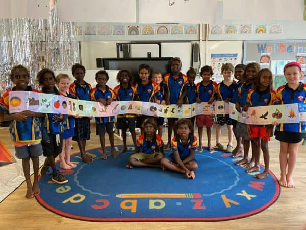 Children at Ngukurr School showing off the Kriol alphabet wall frieze